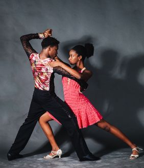 Man and woman in a dancing pose.
